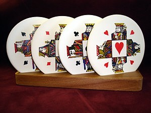 Set of 4 coasters with caddy King and Queen of Hearts Clubs Spades Diamonds card suit motif