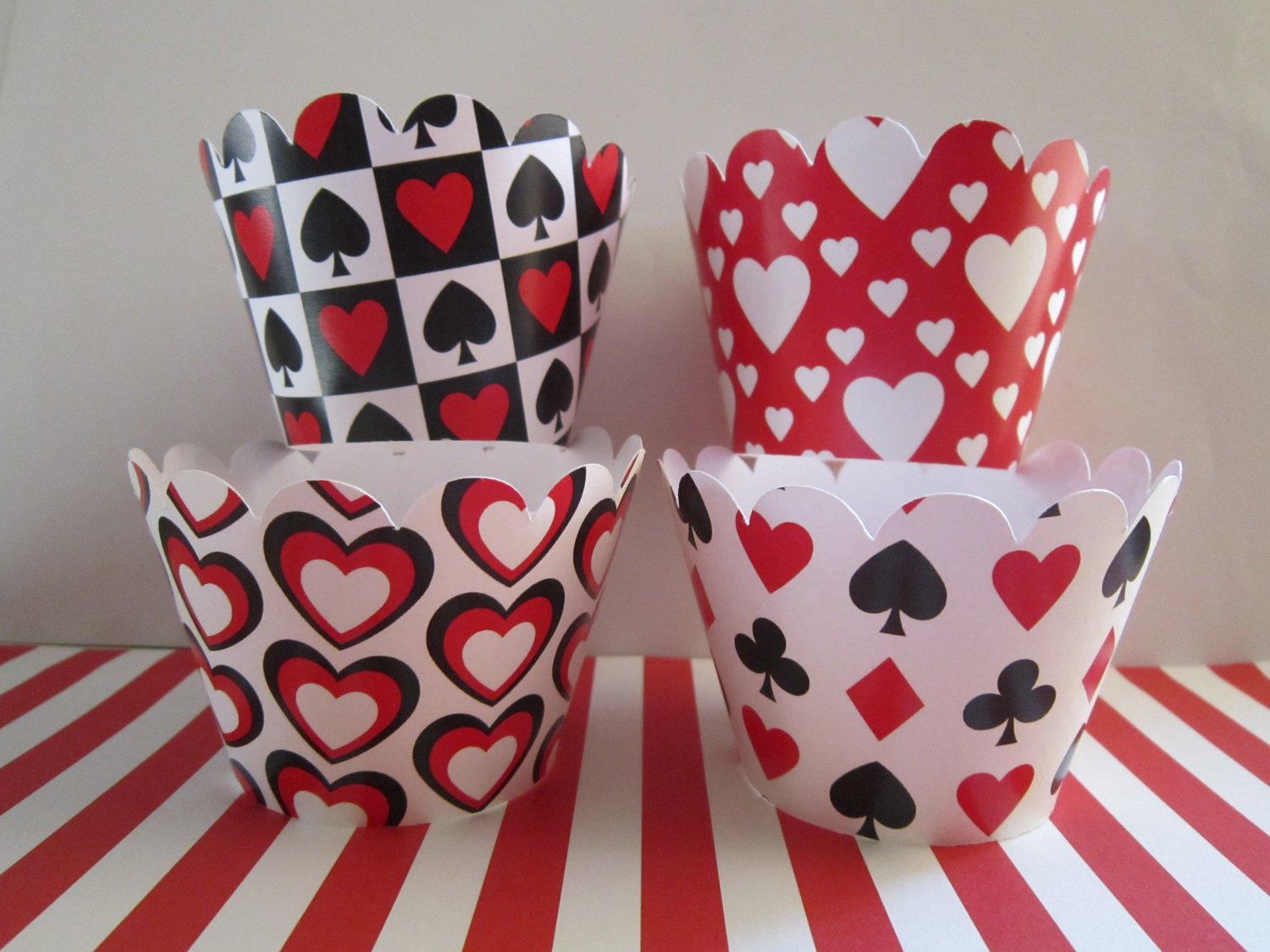 cupcake wrappers with heart club spade diamond card motif